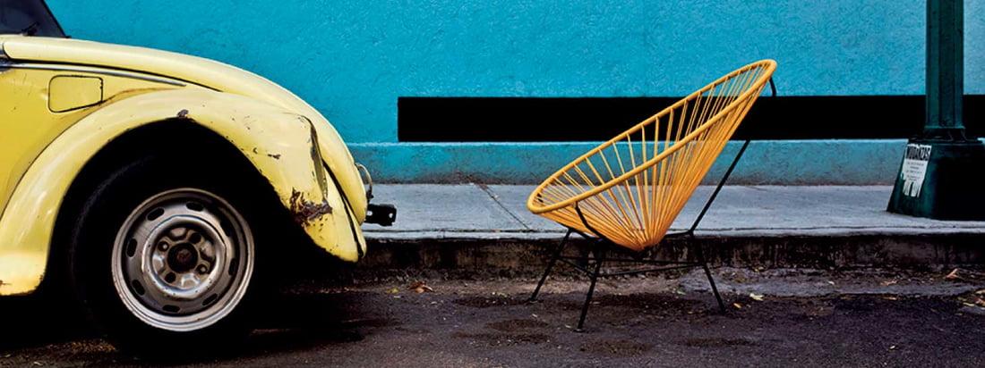 Der Acapulco Chair von Acapulco Design fällt durch seine aussergewöhnliche Sitzschale aus Leder auf. Produziert wird der bequeme Retro-Stuhl in Mexico-City.